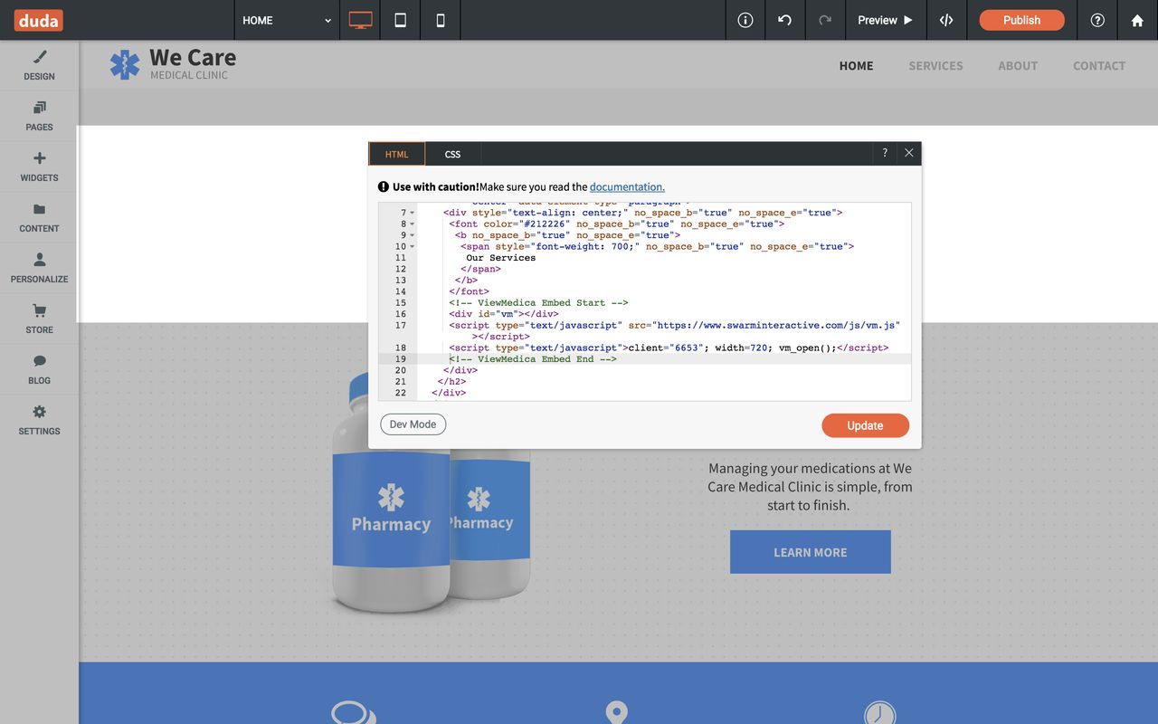 The HTML widget modal is open and the ViewMedica embed code has been pasted into the editor.