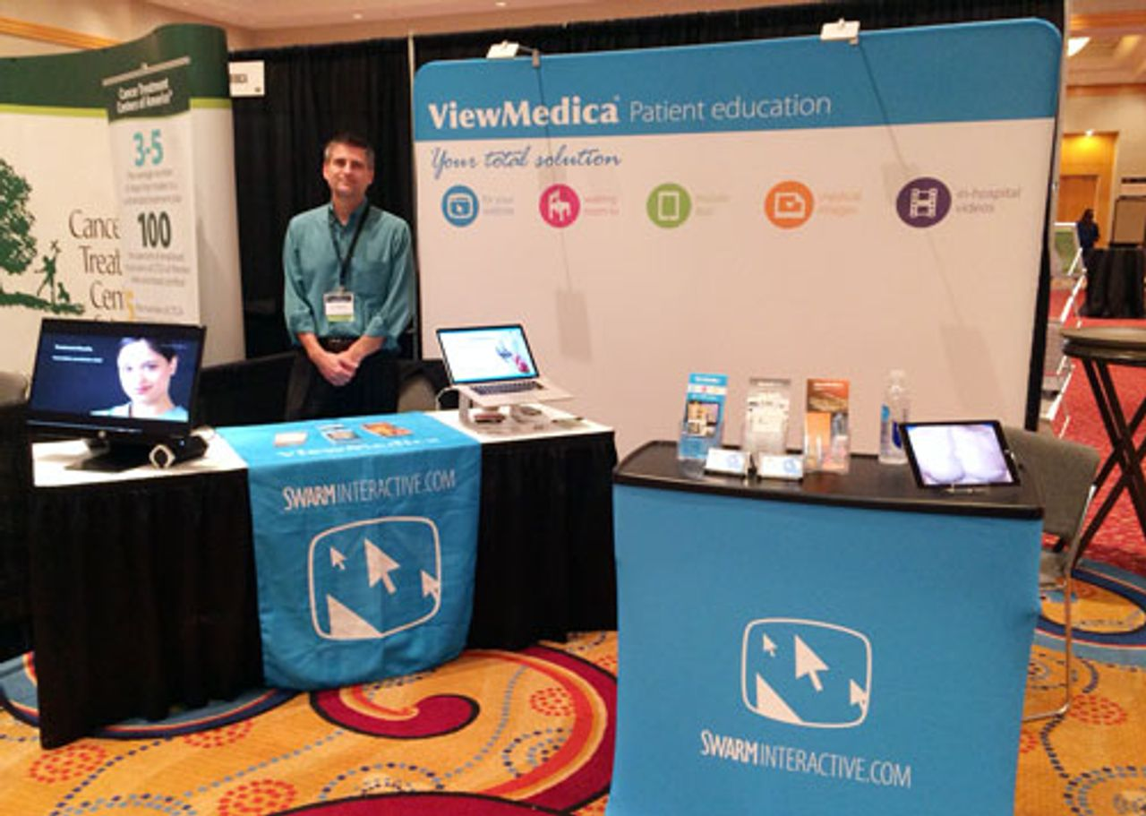 Don Wittekind poses in front of ViewMedicas booth at AAPM 2014.