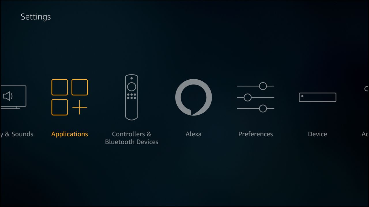 The applications option is selected in the Fire TV settings panel.